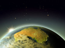 Australia from space during sunrise. Australia with sunrise from Earth's orbit. 3D illustration with detailed planet surface, atmosphere and city lights Royalty Free Stock Photography