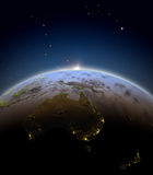 Australia from space during sunrise. Australia during sunrise seen from space. 3D illustration with detailed planet surface. Elements of this image furnished by Royalty Free Stock Photography
