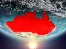 Australia with sun. Australia during sunrise highlighted in red on planet Earth with clouds. 3D illustration. Elements of this image furnished by NASA Royalty Free Stock Image