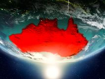 Australia with sun on planet Earth. Australia from orbit of planet Earth in sunrise with highly detailed surface textures and visible country borders. 3D Royalty Free Stock Photo