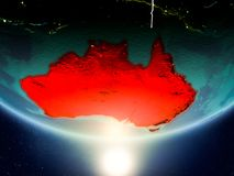 Australia with sun on planet Earth. Australia from orbit of planet Earth in sunrise with highly detailed surface textures and visible country borders. 3D Stock Photography