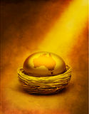 Australia Superannuation Savings Money. A gold egg with the Australian continent, in a nest with a golden tone Royalty Free Stock Images