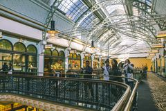 Australia Sydney Queen Victoria Building Interior. Image of people shopping and dining at Queen Victoria Building, Sydney, Australia royalty free stock images