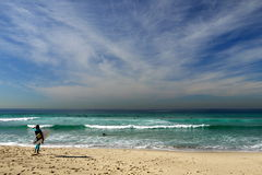 Australia: Tamarama beach woman surfer looking royalty free stock image