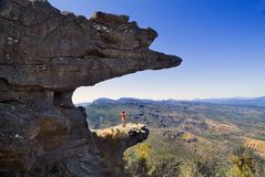 Australia, VIC, Grampians,. Australia, woman on stunning rock formation in Grampians national park named The Balconies royalty free stock photos