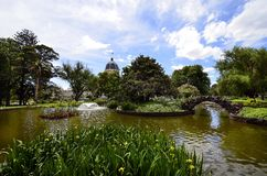 Australia, Victoria, Melbourne, Carlton Gardens. Australia, Melbourne, public Carlton Gardens with pond and Royal Exhibition building stock photos