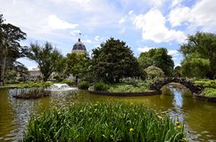 Australia, Victoria, Melbourne, Carlton Gardens. Australia, Melbourne, public Carlton Gardens with pond and Royal Exhibition building royalty free stock photo