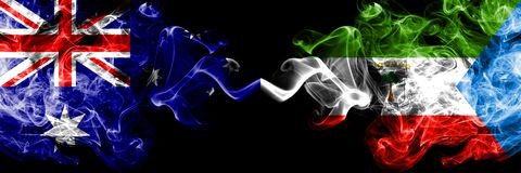 Australia vs Equatorial Guinea smoky mystic flags placed side by side. Thick colored silky smokes combination of national flags of. Australia and Equatorial royalty free stock photos