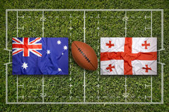 Australia vs. Georgia flags on rugby field Stock Photos