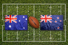 Australia vs. New Zealand flags on rugby field Royalty Free Stock Image