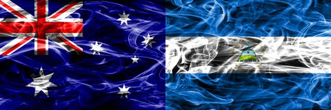 Australia vs Nicaragua colorful smoke flag made of thick smoke. Australia vs Nicaragua colorful smoke flag made of thick smoke stock photo