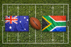 Australia vs. South Africa flags on rugby field. Australia vs. South Africa flags on green rugby field Stock Photography