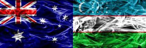 Australia vs Uzbekistan colorful smoke flag made of thick smoke. Australia vs Uzbekistan colorful smoke flag made of thick smoke royalty free stock image