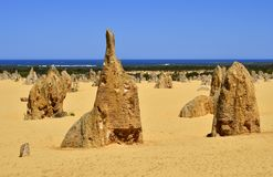 Australia, WA, The Pinnacles in Nambung National Park. Preferred tourist attraction and natural landmark, Indian ocean in background royalty free stock images