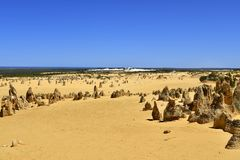 Australia, WA, The Pinnacles in Nambung National Park. Preferred tourist attraction and natural landmark, Indian ocean in background royalty free stock photography