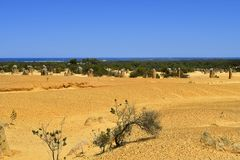 Australia, WA, The Pinnacles in Nambung National Park. Preferred tourist attraction and natural landmark, Indian ocean in background stock photos