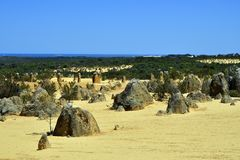Australia, WA, The Pinnacles in Nambung National Park. Preferred tourist attraction and natural landmark, Indian ocean in background royalty free stock photo