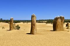 Australia, WA, The Pinnacles in Nambung National Park. Preferred tourist attraction and natural landmark, Indian ocean in background stock image