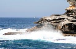 Australia waves & boat. Waves crashing on rocks at Bondi Beach, Sydney, Australia Stock Images