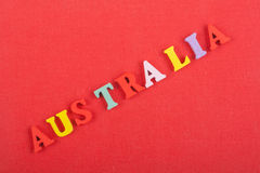 AUSTRALIA word on red background composed from colorful abc alphabet block wooden letters, copy space for ad text. Learning english concept stock images
