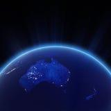 Australia y la nueva ciudad de Zeland se enciende en la noche Foto de archivo libre de regalías