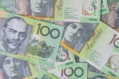 Australian $100 Notes. $100 dollar Australian notes laid down to create a money background Stock Image