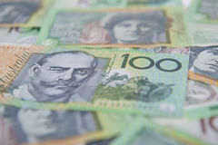 Australian $100 Notes. $100 dollar Australian notes laid down to create a money background Stock Images