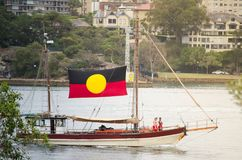 Australian aboriginal people Ancient sailing boat shows in Ferrython and Harbour events on Australia day at Sydney Harbour. stock image