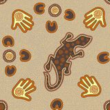 Australian aboriginal seamless pattern with dotted circles, lizard, palms, boomerangs and spirals. Australian aboriginal seamless pattern with colorful dotted Stock Illustration