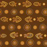 Australian aboriginal seamless vector pattern with dotted circles, rings and boomerangs. Australian aboriginal seamless vector pattern with colorful dotted Stock Illustration