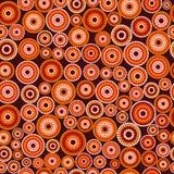 Australian aboriginal seamless vector pattern with dotted circles. Australian aboriginal seamless vector pattern with colorful dotted circles on dark burgundy stock images