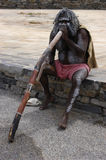 Australian Aborigine playing the Didgeridoo. In traditional dress