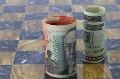 Australian and American dollars stand on game board. American and Australian money stand on chess board reflect themes of global investment, trade partners Stock Images