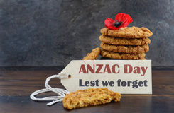 Australian Anzac biscuits. With Anzac DAy, Lest We Forget message on dark wood and slate background stock photo