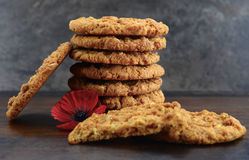 Australian Anzac biscuits. With red poppy for Lest We Forget Anzac or Remembrance Day Royalty Free Stock Photos
