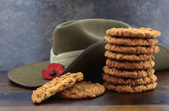 Australian Anzac biscuits. With soldier slouch hat on dark vintage background royalty free stock images