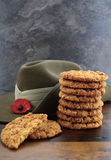 Australian Anzac biscuits. With soldier slouch hat on dark vintage background Stock Photo