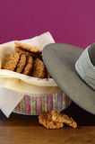 Australian Anzac biscuits. In vintage biscuit tin with army soldier slouch hat Stock Image