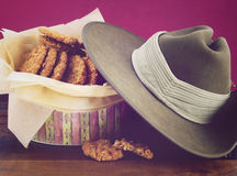 Australian Anzac biscuits. In vintage biscuit tin with army soldier slouch hat, and applied retro vintage style filters Stock Images