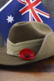 Australian Anzac Day army slouch hat. Anzac army slouch hat with Australian Flag on vintage wood background Royalty Free Stock Photos