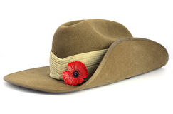 Australian Anzac Day army slouch hat. Anzac Day army slouch hat with red poppy on white background Royalty Free Stock Photo