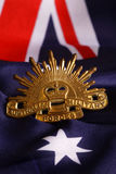 Australian Army badge. An Australian Army badge on an Australian flag background Royalty Free Stock Images