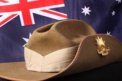 Australian army slouch hat with flag. Australian Army slouch hat with rising sun badge against an Australian flag Royalty Free Stock Photos