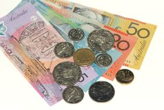Australian banknotes and coins. On plain white background Royalty Free Stock Photos
