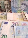 Australian banknotes and euro bills. Commerce, exchange, trade, trading, value, buy, sell, profit, price, rate, cash, currency, paper, money, economic, economy stock image