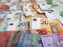 Australian banknotes and euro bills of different denominations. European bills of different denominations, background, commerce, exchange, trade, trading royalty free stock photography