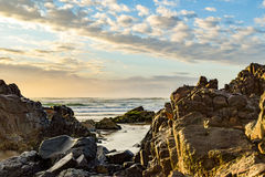 Australian beach coastline at 'Delicate Nobby'. Highlighting rock formations at low tide Stock Photo