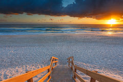 Australian beach entry with stairs in foreground at sunrise Stock Photo