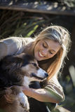 Australian Beauty with Long Blond Hair Sitting with her Collie Dog Stock Photo