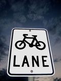 Australian Bicycle Roadsign. Roadside sign for bicycle lane against sky and cloud background Stock Photo